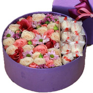 Box round with flowers and rafaello - flowers and bouquets on roza.ck.ua
