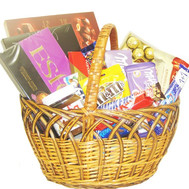 Basket of sweets with sweets and chocolate - flowers and bouquets on roza.ck.ua
