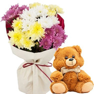 Little bear with a bouquet of chrysanthemums - flowers and bouquets on roza.ck.ua